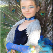 peacock girl in costume