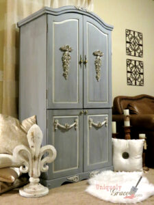 A bluish grey French armoire refinished from a black pine cabinet