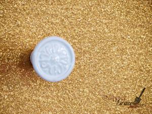 Closeup of glitter logo on Callista coral paradise chalk paint shabby paints uniquely grace