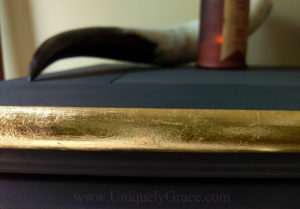 LOGO Gold leaf close up pure origional uniquely grace black truffle dresser