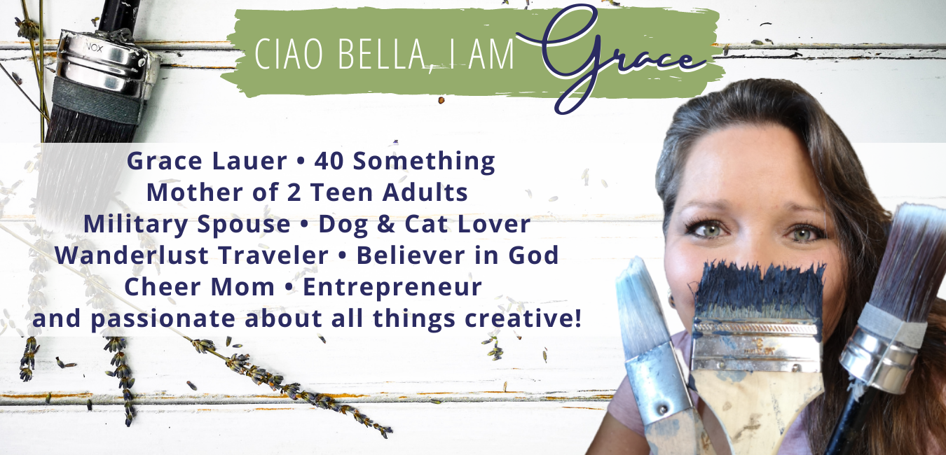 Ciao Bella, I am Grace 40 something mother of 2 animal lover traveler believer in god entrepreneur image of Grace holding brushes in front of her face with her green eyes peeking over the top